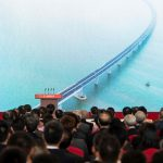 Guests and politics watch a trailer on a giant screen during the opening ceremony of the Hong Kong-Zhuhai-Macau Bridge at the Zhuhai Port terminal on October 23, 2018. - China's President Xi Jinping launched the world's longest sea bridge connecting Hong Kong, Macau and mainland China on October 23 at a time when Beijing is tightening its grip on its semi-autonomous territories. (Photo by FRED DUFOUR / AFP)